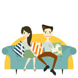 Couple sitting on sofa. flirting and talking about something. Stock Photography