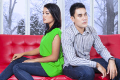 Couple sitting on sofa with mad expression royalty free stock photo