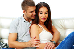 Couple sitting on the sofa together Royalty Free Stock Photography
