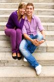 Couple sitting on stairs Stock Photo