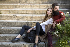 Couple sitting on stairs outdoor Royalty Free Stock Photos