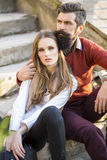 Couple sitting on stairs outdoor Stock Photo