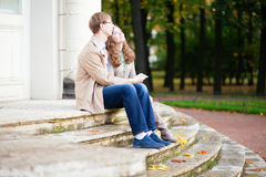 Couple sitting on the stairs together Royalty Free Stock Photography