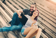 Couple sitting in stairs at university campus Royalty Free Stock Photography