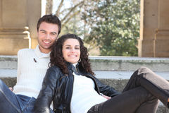 Couple sitting on steps Stock Photography
