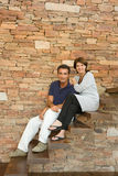Couple sitting on steps Royalty Free Stock Photo
