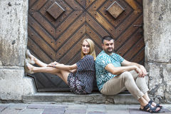 Couple sitting on the steps of the old house. Portrait of loving couple, young family. Royalty Free Stock Photos