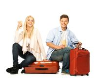 Couple sitting on suitcases Royalty Free Stock Images