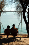 Couple sitting on swing Royalty Free Stock Photography