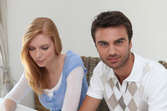 Couple sitting at a table Royalty Free Stock Photos
