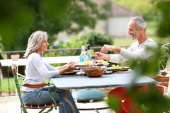 Couple sitting at table for lunch on terrace Royalty Free Stock Image