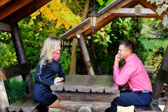 Couple sitting at a table in the park Royalty Free Stock Image