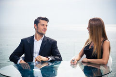 Couple sitting at the table in restaurant Royalty Free Stock Photos