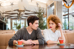 Couple sitting at the table and talking in restaurant Stock Image