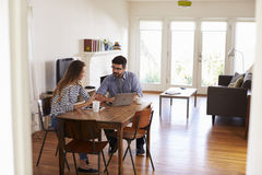 Couple Sitting At Table Using Laptop Together Stock Images