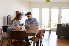Couple Sitting At Table Using Laptop Together Royalty Free Stock Image