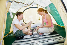 Couple sitting in tent Stock Photos