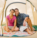 Couple sitting in tent Stock Photography