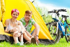 Couple sitting in a tent Stock Photos