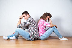 Couple sitting with their backs turned after having an argument.  stock photos
