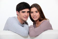 Couple sitting on their couch. Young couple sitting on their couch Royalty Free Stock Images