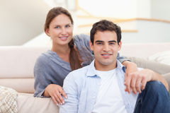 Couple sitting in their living room Stock Photo