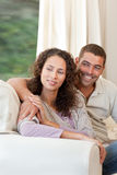Couple sitting in their sofa Royalty Free Stock Photography