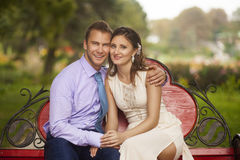 Couple Sitting Together Royalty Free Stock Images