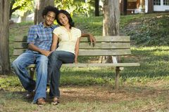 Couple sitting together. Stock Image