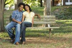 Couple sitting together. stock image
