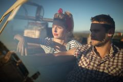 Couple sitting together in a car Stock Photo
