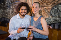 Couple sitting together and having glass of wine Royalty Free Stock Image