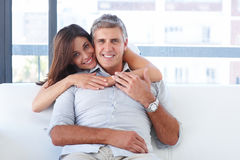 Couple sitting together in the living room Royalty Free Stock Photos