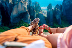 Couple sitting together on the mountain Stock Photo