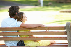Free Couple Sitting Together On Park Bench Stock Photos - 14640423