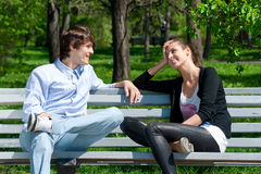 Couple sitting together on park bench Royalty Free Stock Photo