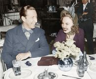 Couple sitting together at a table having fun. (All persons depicted are no longer living and no estate exists. Supplier grants that there will be no model Royalty Free Stock Image