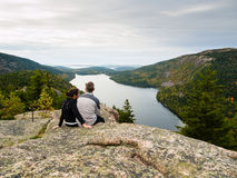 Couple sitting on top of a mountain Royalty Free Stock Photography