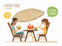 Couple sitting in a tropical cafe Royalty Free Stock Photo