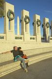 A couple sitting at the U.S. World War II Memorial commemorating World War II, Washington D.C. Stock Photo