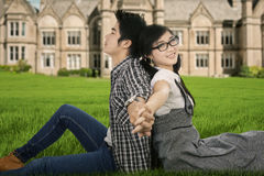 Couple sitting on the university park Stock Photography
