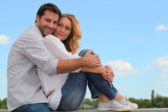 Couple sitting on a wall Royalty Free Stock Photo