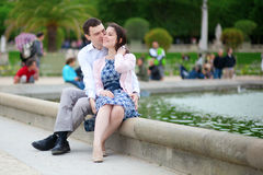 Couple sitting by the water in Luxembourg garden of Par Stock Photos
