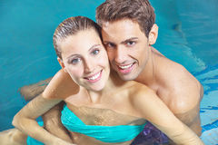 Couple sitting in water of swimming Royalty Free Stock Image