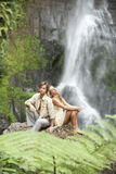 Couple Sitting Waterfalls Royalty Free Stock Images