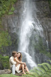 Couple Sitting Waterfalls Royalty Free Stock Photo