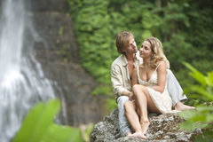 Couple Sitting Waterfalls Stock Photo