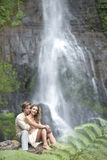 Couple Sitting Waterfalls Stock Image