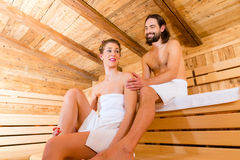 Couple sitting in wellness spa sauna Royalty Free Stock Photos