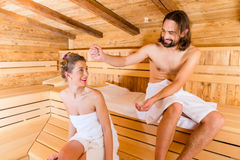 Couple sitting in wellness spa sauna Stock Photography